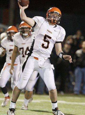 GEORGE LECLAIRE/gleclaire@dailyherald.com ¬ Wheaton Warrenville South's quarterback Reilly O'Toole throws the ball in win at St. Rita in quarterfinal game on Friday in Chicago.
