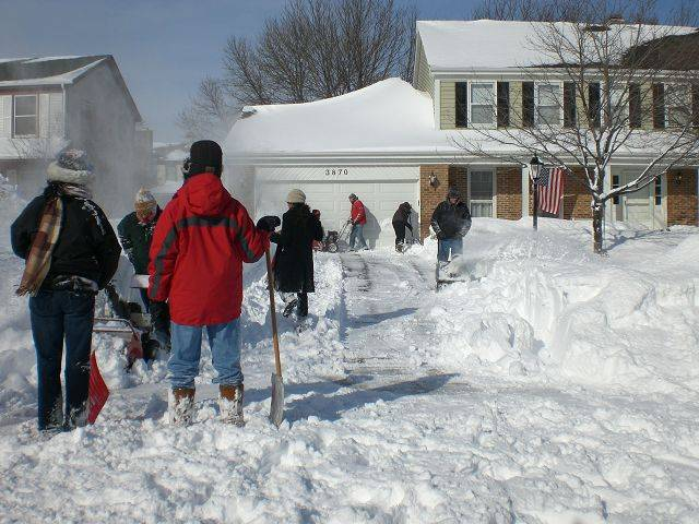 Neighbors shovel out neighbors