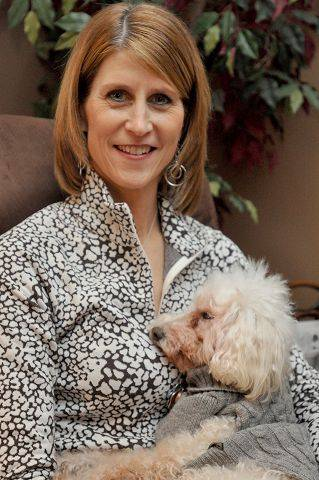Ten days after her kidney donation, Brenda Bogue talks about how she returned to work, feels great and that it's a safe surgery that helps save lives. She's with her 20-year-old miniature poodle Bixby.