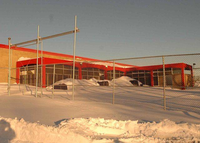 A portion of the Kmart garden center roof in Naperville collapsed under the weight of heavy snow Thursday morning and the remaining sections of the roof were deemed unstable.