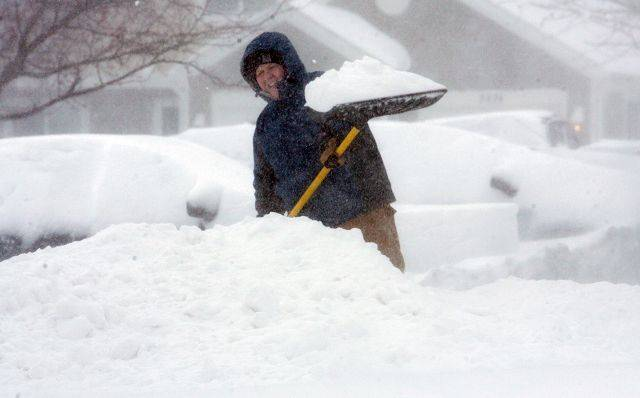 Brad Strohl of Aurora works at digging out his driveway from the blizzard Wednesday. He wasn't planning on going anywhere, but wanted to get the shoveling done before temperatures dropped on Thursday.