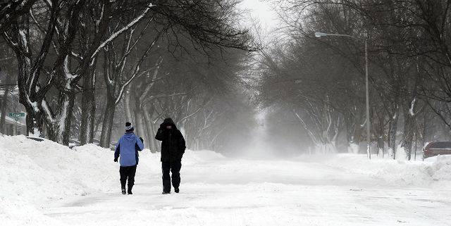 Sean and Maryann Kopeny of Palatine walk the loney streets Wednesday morning.