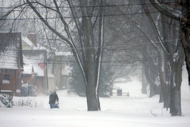The clearing of the snow begins as large amounts of snow hits the Elgin area.