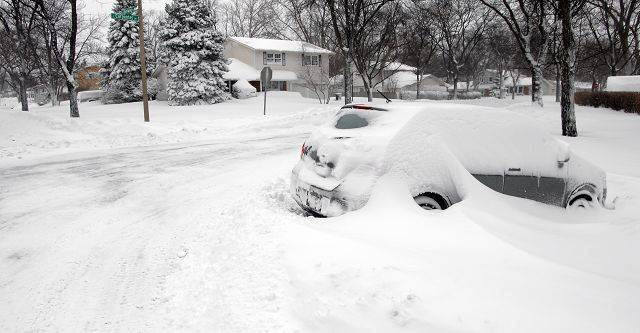 Abandoned cars dot the landscape in Palatine Wednesday morning.