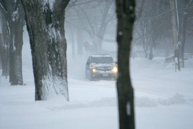 A car navigates the snow-filled roads after large amounts of snow fell on the Elgin area Wednesday.