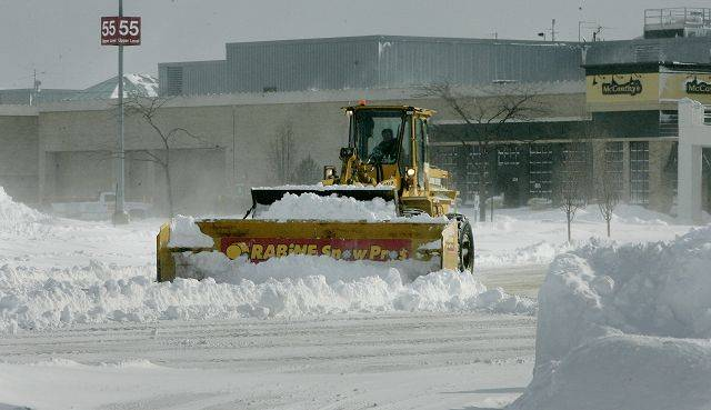 A snow plow clears the parking lot at Westfield Shoppingtown Hawthorn in Vernon Hills after the blizzard hit the area Wednesday in Lake County. The mall was closed Wednesday.