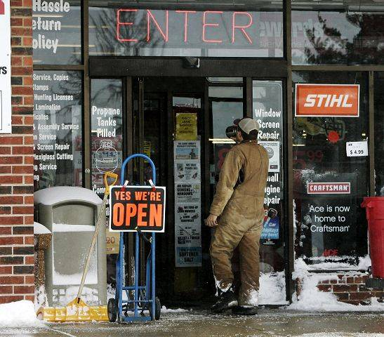 A man walks into Ace Hardware in Libertyville which opened after the blizzard hit the area Wednesday in Lake County.