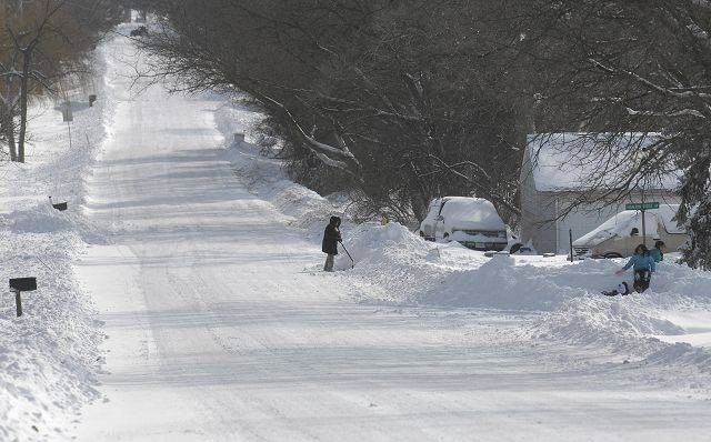 Roads in Lily Lake were plowed and protected from snow drifts, but outside of town, cars were abandoned on Route 47.