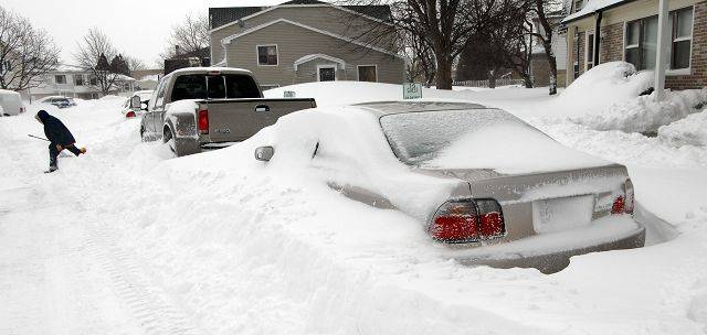 Buried cars line the streets in Palatine as their owners dig out from the snowstorm.