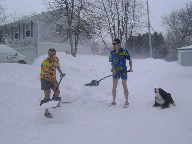 Marlin & Austin Keesler shoveling snow while wearing comfortable Hawaiian apparel.