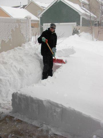 Kristina Sparks digs out in Elgin.