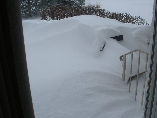 There is a patio somewhere under all this snow.
