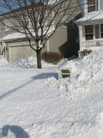 Mail delivery resumes today, but it's going to be tough for a carrier to get to Kathryn Nunes' box in Lisle.