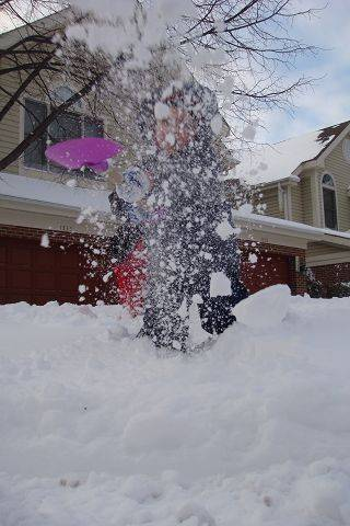 Holly Steveson's 3-year-old son, Tyler, helps (well, sort of) shovel snow in Arlington Heights.