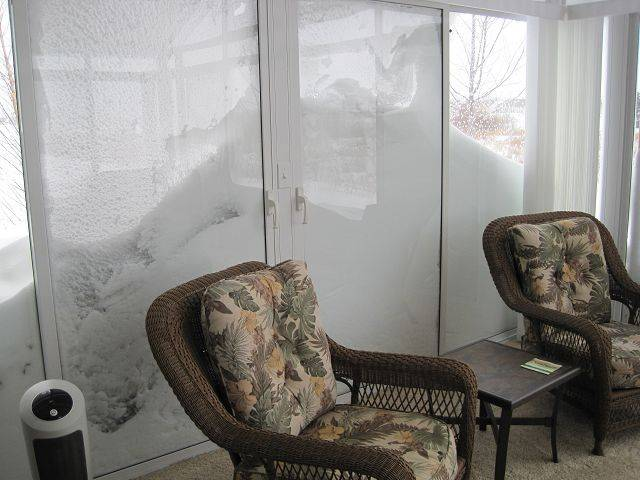 Lynne and Denny Freund's windows at Del Webb, Huntley is almost covered by a snow drift.