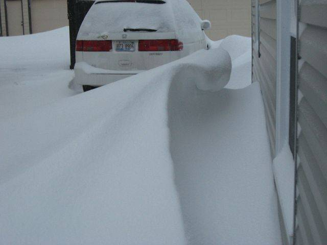 The wind and snow form a perect wave at Navreet Kaur Heneghan's home in Lombard.