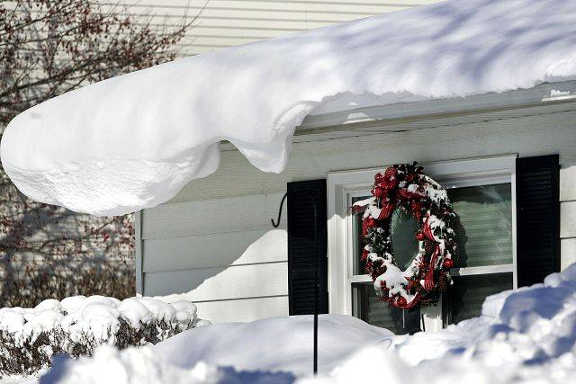 Snow smothers the roof of this home on Golf Road in Libertyville after about 20 inches of snow fell in town during the Blizzard of 2011.