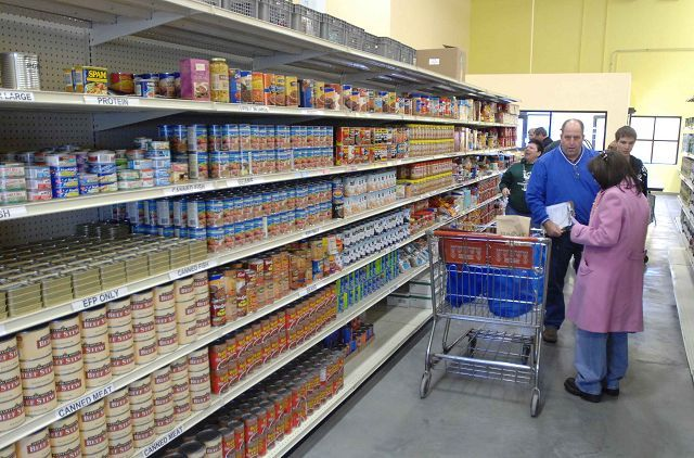 Volunteers assist clients in choosing food items at Loaves and Fishes Community Pantry's new distribution center and warehouse Saturday in Naperville.