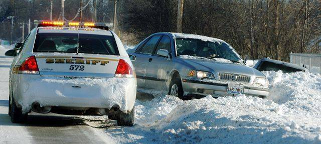A car slid into a ditch early Thursday on an icy Route 176 just west of Island Lake. The blizzard was the third worst in state history on record.