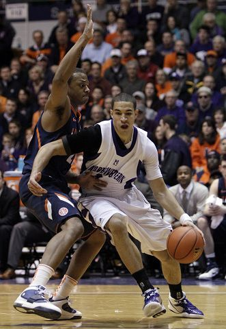 Northwestern's Drew Crawford of Naperville drives to the basket as Illinois' Jereme Richmond of Waukegan tries to defend. Northwestern won 71-70 Saturday in Evanston, and Crawford contributed 12 points and 5 rebounds.