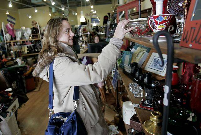 Anja Kusch of Libertyville checks the selections at ReNew Family Consignment in Libertyville.