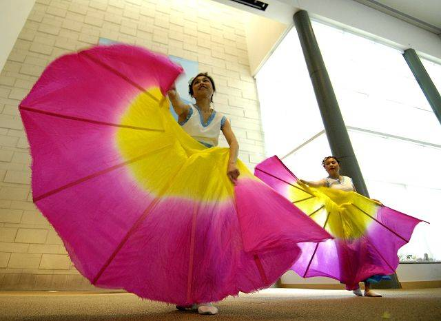 "A group of dancers perform ""Color Clouds Chasing Moon"" at Friendship Village in Schaumburg."