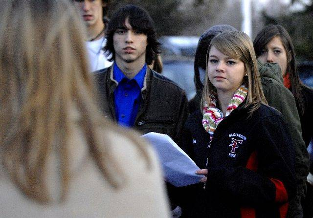 Dundee-Crown sophomore Emily Voyles looks to Mary Tortorice, VP/Deputy General Council of the Sears Holdings Management Corporation, after giving a speech with members of the Youth Labor Committee in the parking lot of the Sears Holdings campus in Hoffman Estates Friday, Dec. 10.