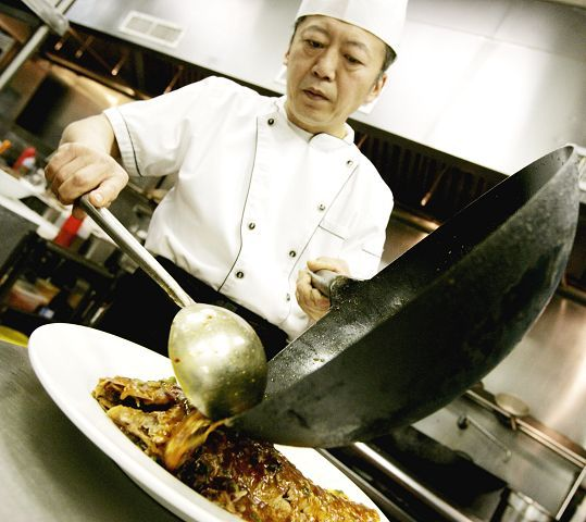 Chef Adam Liang prepares a variety of dishes at Lu's Sushi and Chinese in Glen Ellyn.