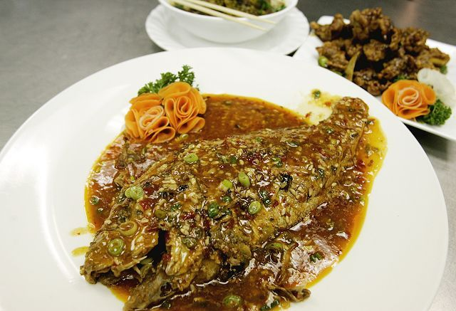 Sichuan-style fish comes bathed in a savory sauce at Lu's Sushi and Chinese in Glen Ellyn.