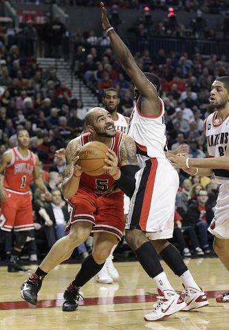 Bulls forward Carlos Boozer, going to the basket against Portland Wesley Matthews, returns to Utah on Wednesday night.