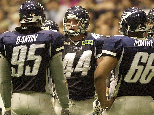 Former Rush fullback/linebacker Bob McMillen, center, will have his No. 44 jersery retired this season by the Chicago Rush. McMillen, a Naperville resident, is now the head coach of the Arena Football League team.