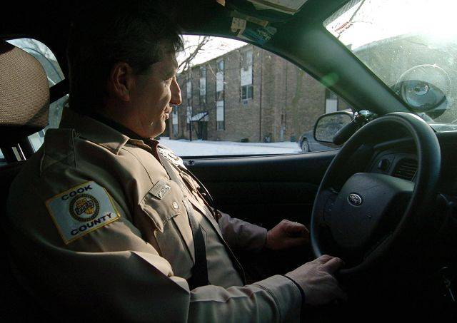 Cook County Sheriff's Police Officer Steve Hudak patrols Country Glen Apartments in unincorporated Cook County near Arlington Heights. Looking to save money, the county would like to annex such areas to towns and leave policing up to them.