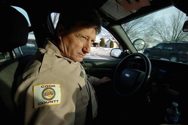 Cook County Sheriff's Police Officer Steve Hudak patrols unincorporated areas near Arlington Heights. Looking to save money, the county would like to annex such areas to towns and leave policing up to them.