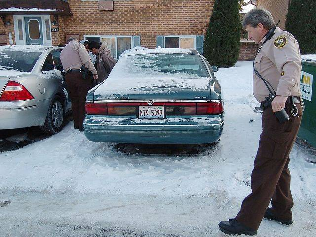 Cook County Sheriff's Police Officers James Hannigan, left, and Steve Hudak make an arrest at Long Valley Apartments in an unincorporated area near Palatine.