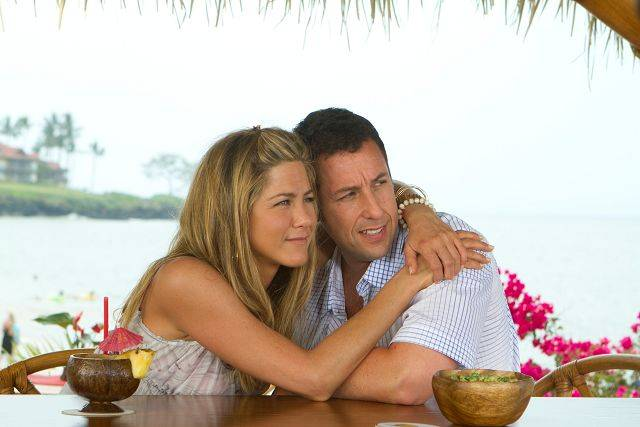 "Katherine (Jennifer Aniston) pretends to be the future ex-wife of Danny (Adam Sandler) the plastic surgeon in the rom-com ""Just Go With It."""