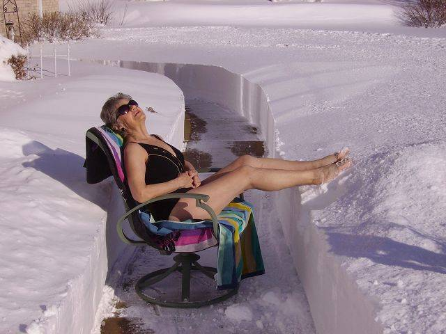 "Phyllis Meyer gets some sunshine in East Dundee after the big blizzard. ""Cheer up, spring is coming,"" says Paul Meyer."