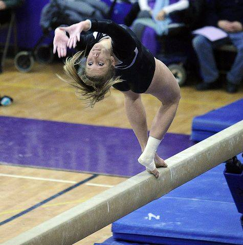 South Elgin (Coop) Taeopae Wetterman does her flip on the balance beam at the 2011 Sectional Gymnastics Championships at Niles North High School on Thursday.