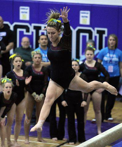 Schaumburg's Brooke Shimon performs her balance beam routine Thursday during competition at the Niles North sectional. Shimon won the all-around, including first places on balance beam and uneven bars.