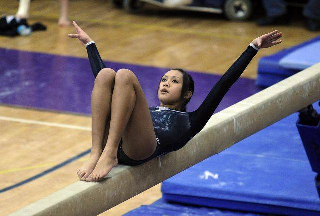 South Elgin's Liz DeLeon on the balance beam at the 2011 Sectional Gymnastics Championships at Niles North High School on Thursday.