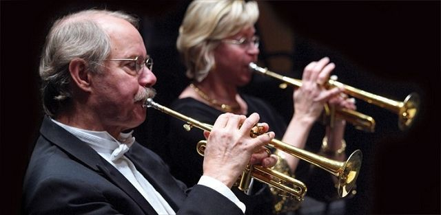 Charles Geyer and Barbara Butler build a life together as husband and wife and dad and mom. They both work as music professors at Northwestern University. They even share the spotlight here as the co-principal trumpets in Music of the Baroque.