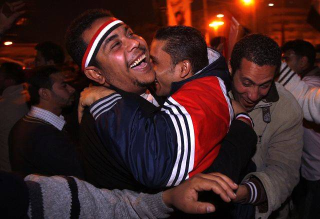 Egyptians hug each other as they celebrate after President Hosni Mubarak resigned and handed power to the military at Tahrir Square, in Cairo, Egypt, Friday, Feb. 11, 2011.