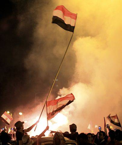 Egyptians celebrate after President Hosni Mubarak resigned and handed power to the military in Cairo, Egypt, Friday, Feb. 11, 2011.