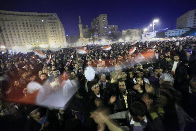 Anti-government protesters celebrate in Tahrir Square in downtown Cairo, Egypt Thursday, Feb. 10, 2011.