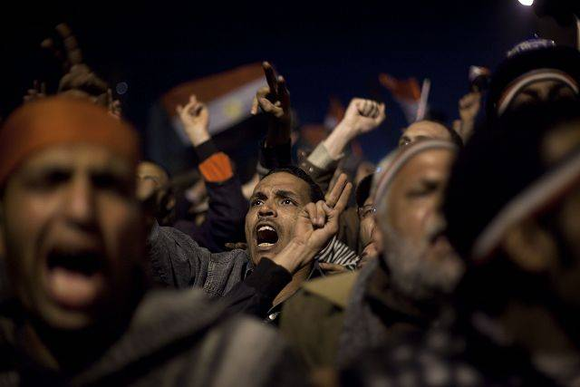 Anti-government protesters react as Egyptian President Hosni Mubarak makes a televised statement to his nation in Tahrir Square in downtown Cairo, Egypt Thursday, Feb. 10, 2011.