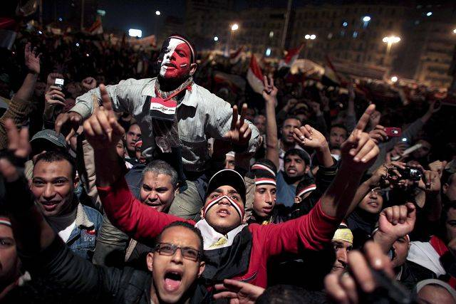 Egyptians celebrate the news of the resignation of President Hosni Mubarak.