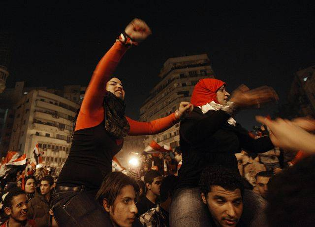 Egyptian citizens celebrate after President Hosni Mubarak resigned and handed power to the military at Tahrir square, in Cairo, Egypt, Friday, Feb. 11, 2011.