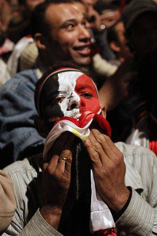 An Egyptian man celebrates the news of the resignation of President Hosni Mubarak.