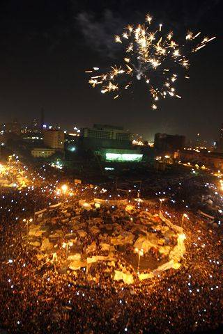 Egyptians set off fireworks as they celebrate after President Hosni Mubarak resigned and handed power to the military at Tahrir Square, in Cairo, Egypt, Friday, Feb. 11, 2011.