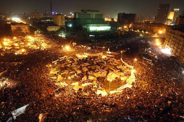 Egyptians celebrate after President Hosni Mubarak resigned and handed power to the military at Tahrir Square, in Cairo, Egypt, Friday, Feb. 11, 2011.
