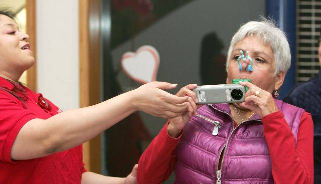 Marge Merchut, right, of Carol Stream, performs a pulmonary function test given by respiratory therapist Sana Khan during Adventist GlenOaks Hospital's Walk the Mall for Life program held Saturday inside Stratford Square Mall in Bloomingdale.